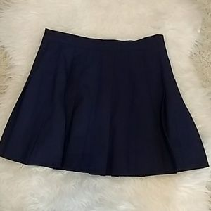 Dresses & Skirts - Navy Blue pleated skirt. Size small